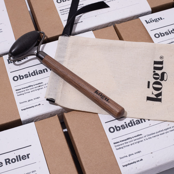 Kogu obsidian face roller with packaging and pouch